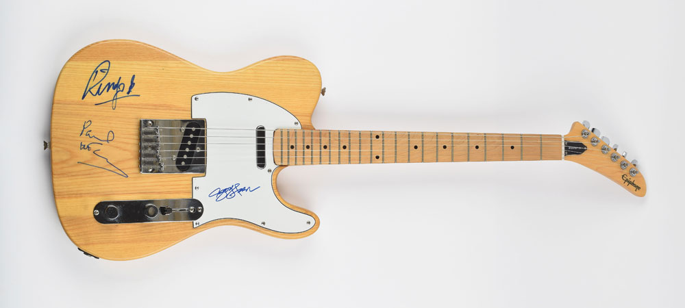 Beatles autographs Extremely rare Beatles-signed Gibson Epiphone Telecaster-style electric guitar, signed by Paul McCartney, George Harrison, Ringo Starr, offered by RR Auction